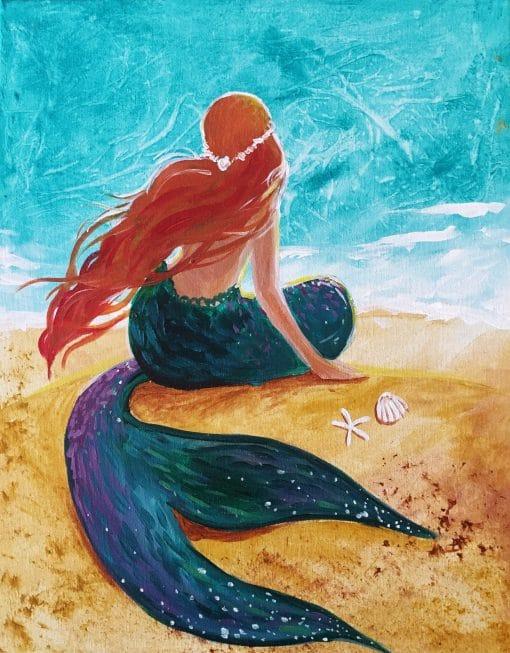 Mermaid sun bathing with ocean and sea shells